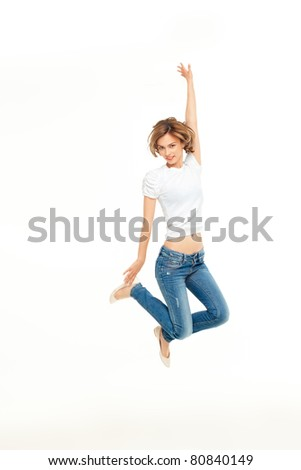 young casual woman jumping exited with hands in the air - stock photo