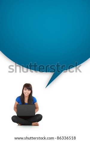young casual woman sitting down smiling holding laptop with box word isolated background - stock photo