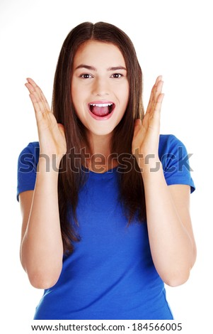 Young casual woman student expresses shock, surprise. Isolated on white.