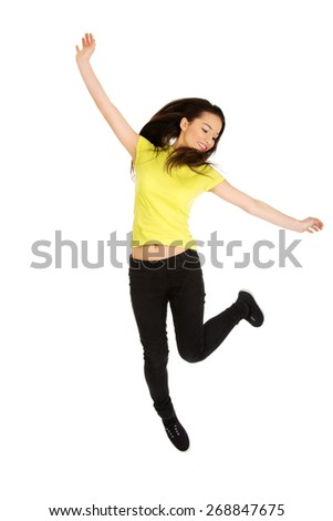 Young casual woman student jumping. - stock photo