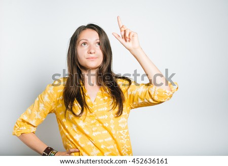young casual woman suddenly remember something important - stock photo