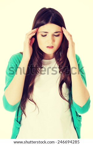 Young casual woman suffering from headache. - stock photo