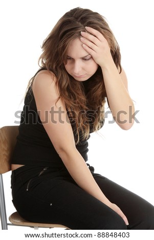 Young casual woman with depression isolated on white - stock photo