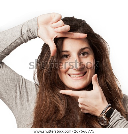 young casual woman with frame on face gesture - stock photo