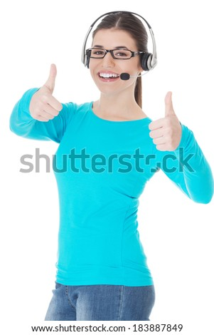 Young casual woman with headphones and microphone showing ok. Isolated on white. - stock photo