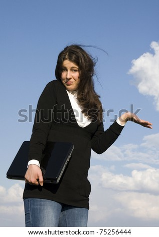Young casual woman with laptop enjoys outdoor relaxing - stock photo