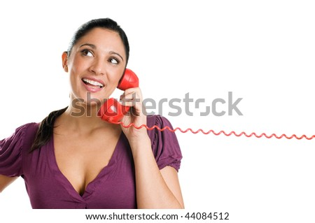 Young casual woman with red receiver dreaming and smiling at the phone call