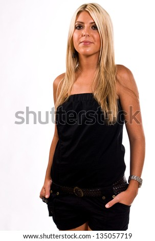 Young Caucasian blonde female facing left of camera with her head turned to the camera and smiling. - stock photo
