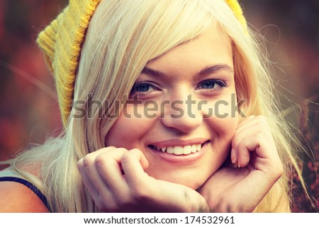 Young caucasian blonde in yellow cap lieing in heather - stock photo