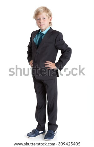 Young Caucasian boy a businessman full length in suit and tie, isolated on white background - stock photo