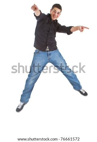 Young caucasian boy jumping in joy. Isolated over white background.