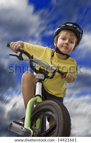 Young Caucasian Boy Riding a Bicycle to School - stock photo