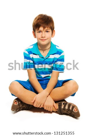Young Caucasian boy sitting on the floor isolated on white - stock photo