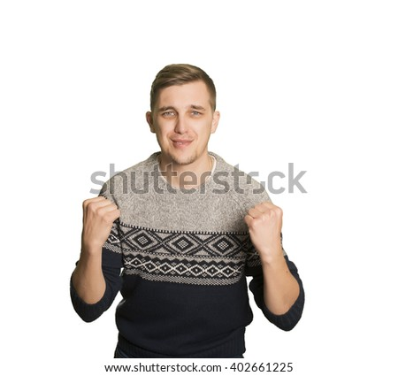 Young caucasian boy with a winner gesture - stock photo