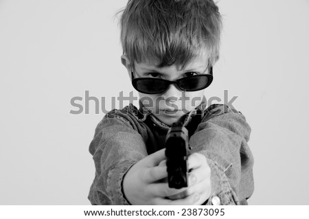 Young Caucasian boy with gun toy - stock photo