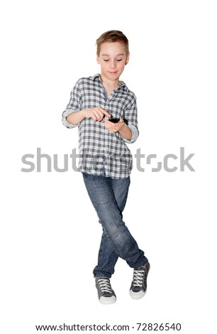 young Caucasian boy with touch phone on white background - stock photo