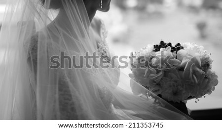 Young caucasian bride. Black and white wedding picture.  - stock photo