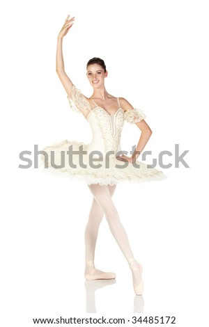 Young caucasian brunette ballerina girl on white background and reflective white floor showing various ballet steps and positions. Not Isolated