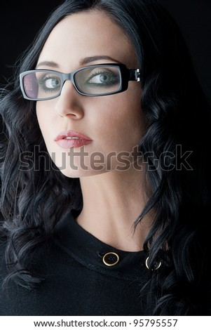 young caucasian brunette wearing glasses, close-up studio shot - stock photo