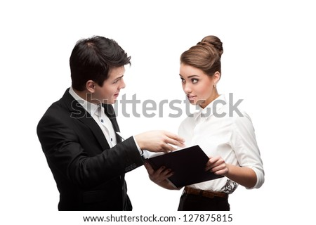 young caucasian businessman and woman holding diary book and having discussion - stock photo