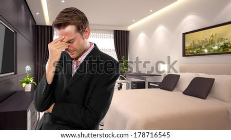 young caucasian businessman in a 3d rendered hotel - stock photo