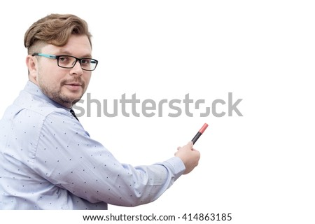 Young caucasian businessman pointing on whiteboard. Education, presentation, language learning concept. Isolated. Text space - stock photo