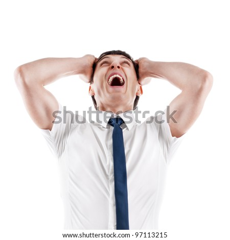 Young caucasian businessman screaming and pulling his hair, isolated on white