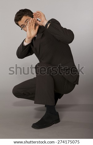Young caucasian businessman suprised and affraid - stock photo