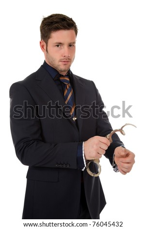 Young caucasian businessman who put handcuffs on hand . Studio shot. White background - stock photo