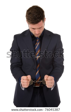 Young caucasian businessman with handcuffed hands . Studio shot. White background - stock photo