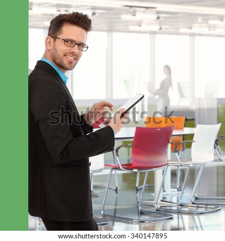 Young caucasian businessman working in creative colorful office. - stock photo