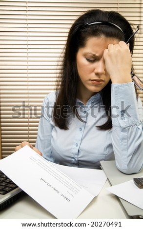 Young caucasian businesswoman received the notice of layoff - stock photo