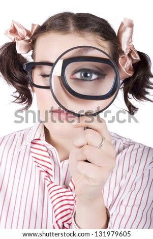 Young caucasian businesswoman wearing eyeglasses looking with one eye through magnifying glass - stock photo