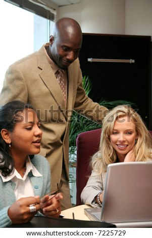 Young caucasian businesswoman with her business team - stock photo