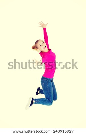 Young caucasian cheerful woman is jumping.