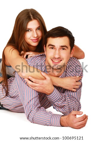 Young caucasian couple lying on floor and hugging