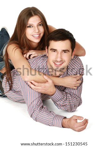 Young caucasian couple lying on floor and hugging , isolated on white background