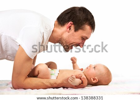 Young Caucasian father playing with baby son - stock photo