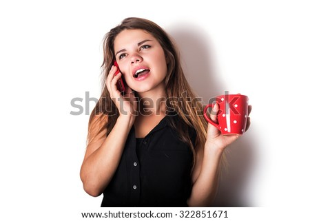 young caucasian female speaking on phone and drinking coffee or tea isolated on white - stock photo