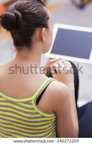 Young Caucasian Female Using Personal Tablet Computer In Home Environment. Vertical Image Composition - stock photo