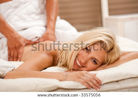 Young caucasian getting a romantic massage - stock photo