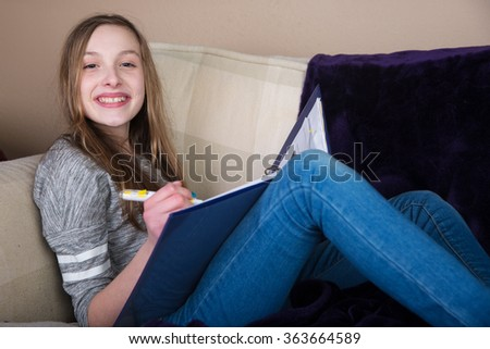 Young Caucasian girl doing homework - stock photo
