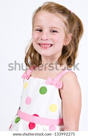 Young Caucasian girl in a polka dot dress - stock photo