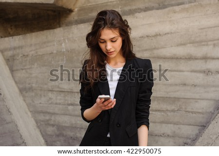 Young Caucasian Girl Text Messaging Looking At The phone. - stock photo