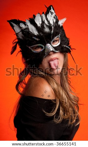 Young caucasian girl wearing a cat mask. - stock photo
