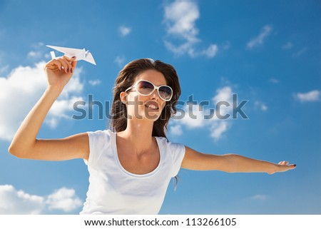 Young caucasian girl with two paper plane in the hand - stock photo