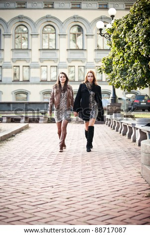 Young caucasian girls walking together holding hands - stock photo