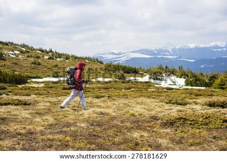 young caucasian guy hiking outdoors - stock photo