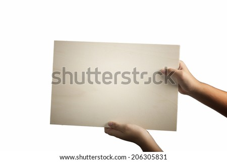 Young caucasian hands holding a light color plywood square blank signboard isolated on white background. There are no elements to distract viewer from looking at any  message written on the sign - stock photo