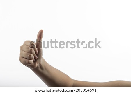 Young caucasian hands making hitch-hiking gesture from right to left isolated on a white background. Gesture is approve or like or number one sign too. Elbow is supported by a white table with shadow - stock photo